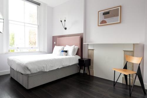 Cama o camas de una habitación en The Dome Notting Hill
