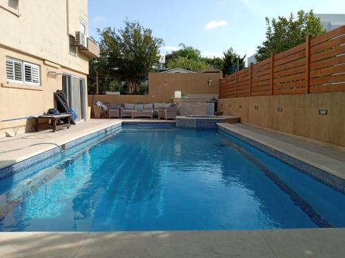 The swimming pool at or near וילה מצודת ים