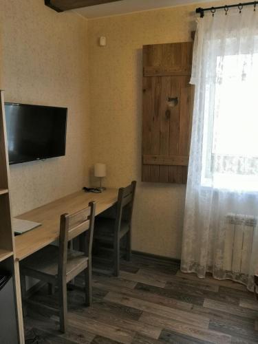 Телевизор и/или развлекательный центр в Гостевой дом Три кота