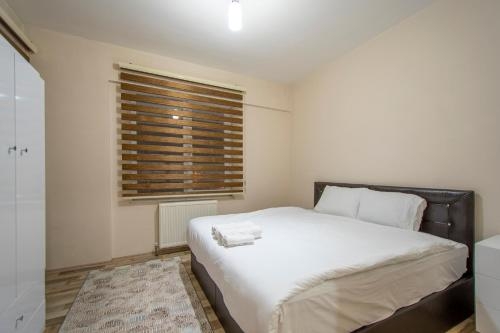 A bed or beds in a room at Adapark Rezidans