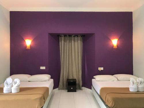 Katil atau katil-katil dalam bilik di Changlun Chalet