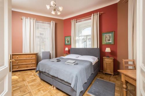 Ein Bett oder Betten in einem Zimmer der Unterkunft Liliova Apartments