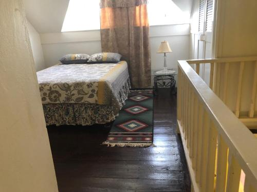 A bed or beds in a room at Club Caribbean Court Apartments