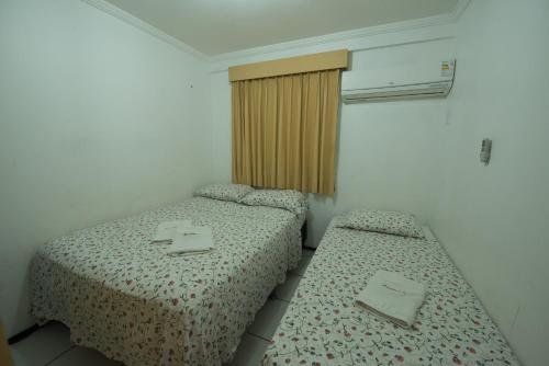 A bed or beds in a room at Porto de Iracema 630