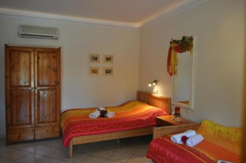 A bed or beds in a room at Lysistrata Bungalows