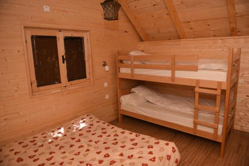 A bunk bed or bunk beds in a room at Kod Draskovica
