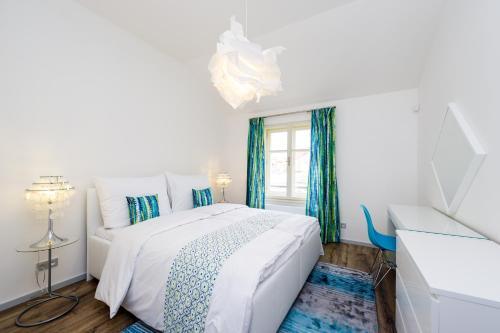 Un ou plusieurs lits dans un hébergement de l'établissement EMPIRENT Mucha Apartments