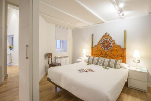 Ein Bett oder Betten in einem Zimmer der Unterkunft Oldtown San Sebastián Apartments