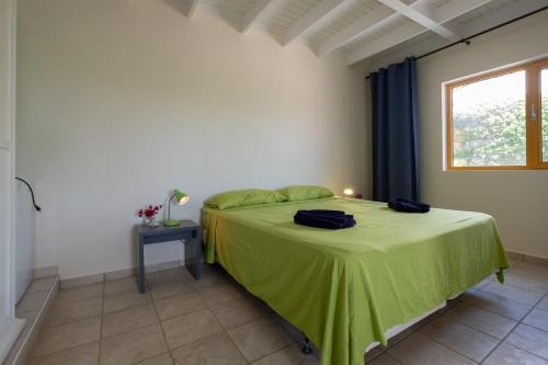 A bed or beds in a room at The Natural Curacao