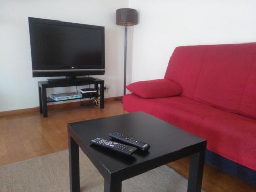 Uma área de estar em Zé da Rita Apartment