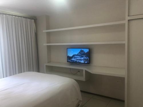 A television and/or entertainment centre at Ap Praia De Iracema Fortaleza