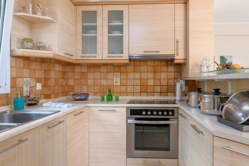 Η κουζίνα ή μικρή κουζίνα στο Casa Elisabetta Corfu