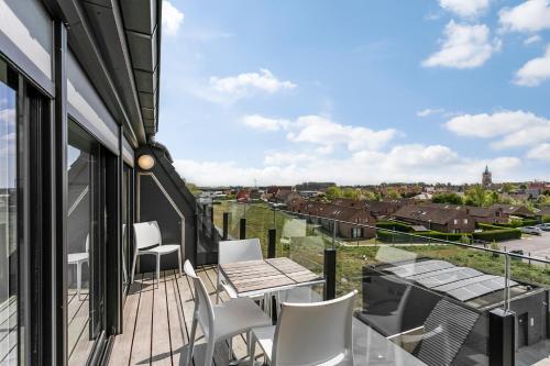 Ein Balkon oder eine Terrasse in der Unterkunft Belcasa Family Suites & Lofts