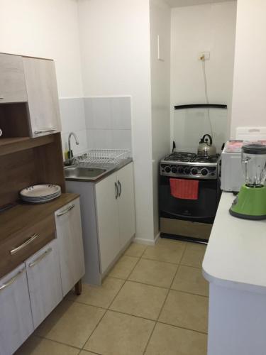 A kitchen or kitchenette at Depto Marga Marga Quilpué