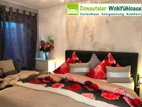 A bed or beds in a room at Donautaler Wohlfühloase