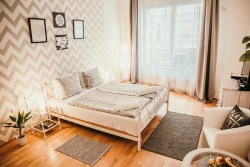 A bed or beds in a room at Elite Apartments Budapest