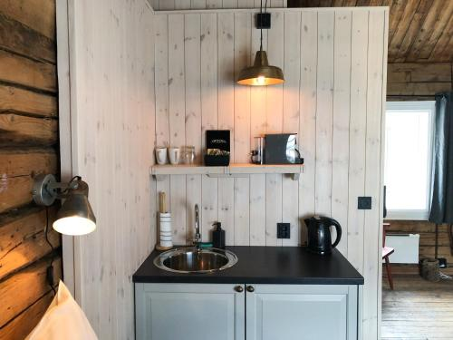 A kitchen or kitchenette at Reine Rorbuer - by Classic Norway Hotels