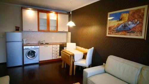 A kitchen or kitchenette at Apartment House Sofia