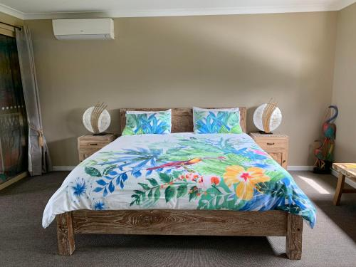 A bed or beds in a room at Albany Bali Style Accommodation