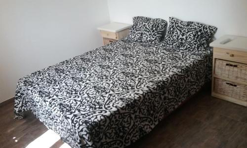 Una cama o camas en una habitación de Depto playa Necochea