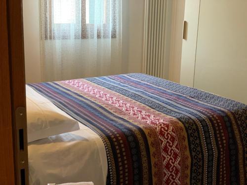 A bed or beds in a room at Grimaldi Apartments Cannaregio & Dorsoduro