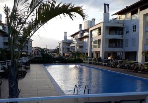 Piscina en o cerca de Apartamento Praia do Campeche