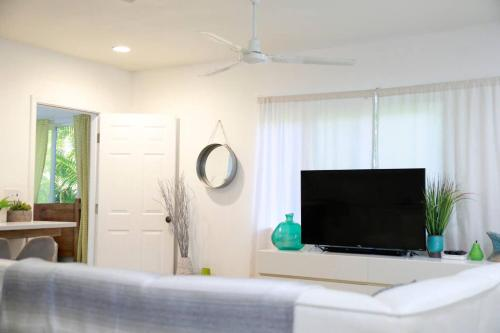A television and/or entertainment center at Modern Hawaii Beach House