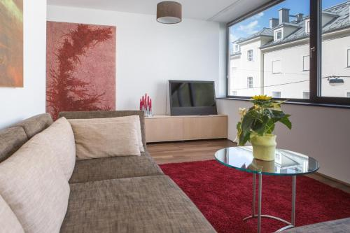 A seating area at Salzburg City Appartement