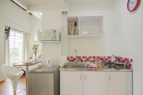 A kitchen or kitchenette at Studios Jovita House