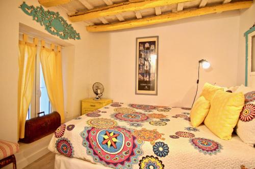 A bed or beds in a room at Loft Rincon del Artista