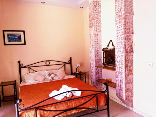 A bed or beds in a room at Saint Konstantin Beach Apartments