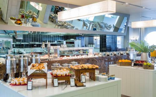 A restaurant or other place to eat at Hilton Surfers Paradise Residences