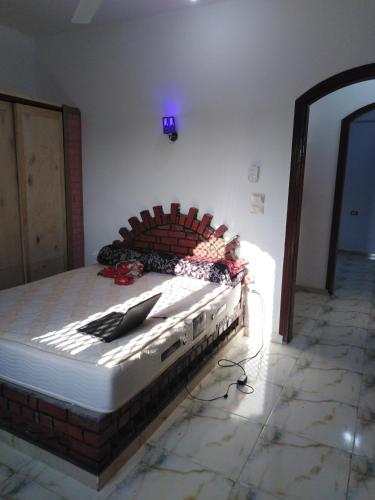 A bed or beds in a room at West Side of luxor