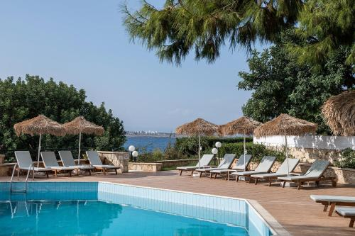 The swimming pool at or near Alianthos Suites
