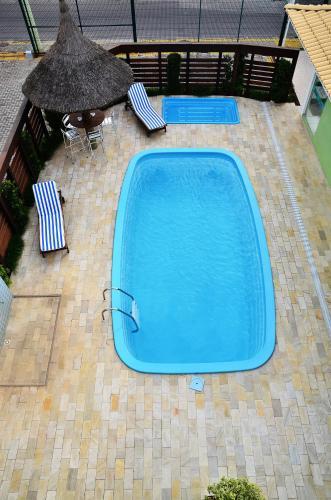 The swimming pool at or near Pousada Mar Do Leste
