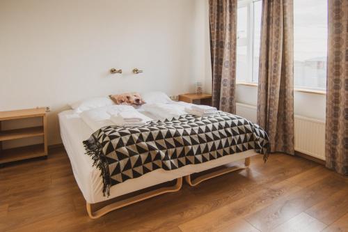 福拉姆提德公寓和度假屋房間的床