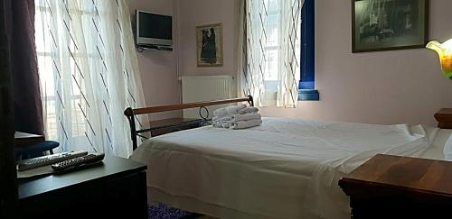 A bed or beds in a room at Archontiko Zarkada
