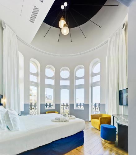 A bed or beds in a room at Casa Alberola Alicante, Curio Collection By Hilton