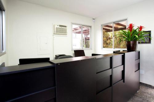 A kitchen or kitchenette at Pampulha Flat