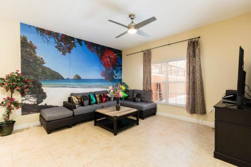A seating area at Paradise Palm Resort Villa