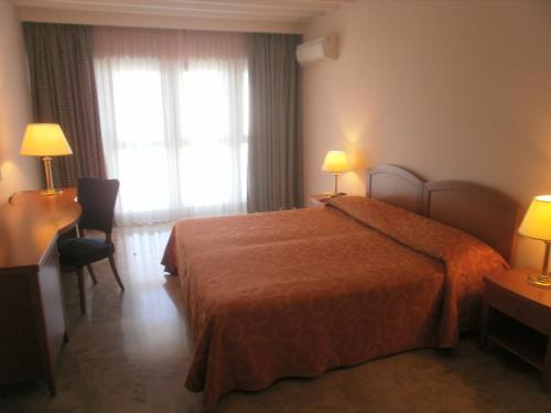 Кровать или кровати в номере Residence Garden