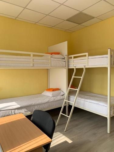 A bunk bed or bunk beds in a room at Hostel Uyutnyy Dom