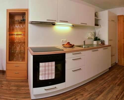 A kitchen or kitchenette at Apartments Rezia
