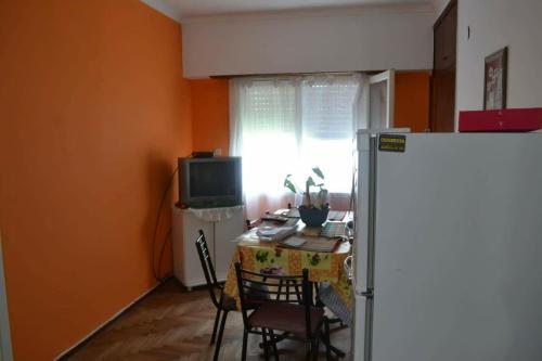 Una televisión o centro de entretenimiento en Departamento para familias (6 personas) totalmente equipado