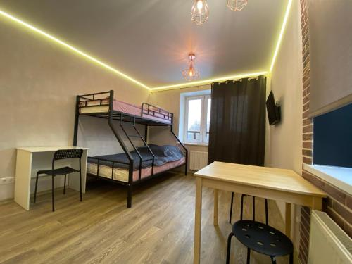 A bunk bed or bunk beds in a room at Студия ЛОФТ