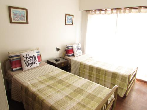 A bed or beds in a room at Casa Buena Vista Tandil
