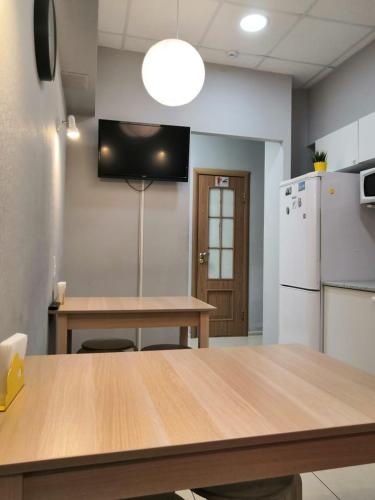 A television and/or entertainment center at Mini Hotel by Riviera