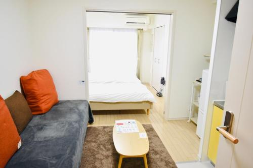 A bed or beds in a room at 1min Walk To The Station