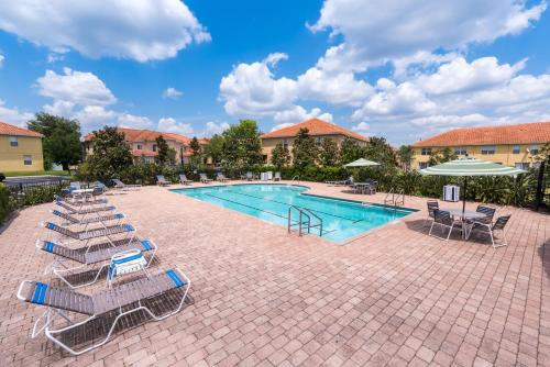 The swimming pool at or close to Lovely Disney Vacation House