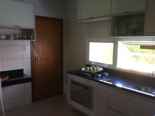 Una cocina o zona de cocina en Casa a Beira mar , praia , condomínio Aracaju